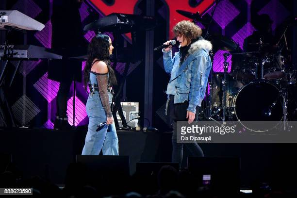Demi Lovato and Trevor Dahl of Cheat Codes perform onstage at the Z100's Jingle Ball 2017 on December 8 2017 in New York City