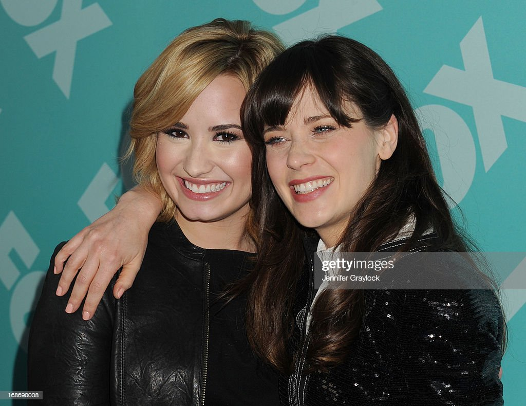 Demi Lovato and Zooey Deschanel attend the FOX 2103 Programming Presentation Post-Party at Wollman Rink in Central Park on May 13, 2013 in New York City.