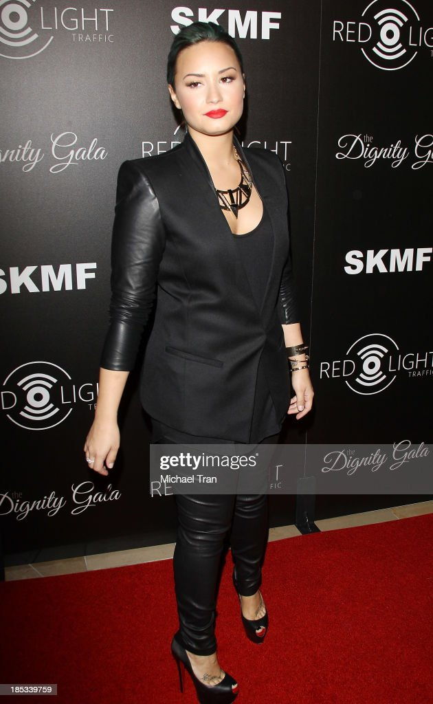 <a gi-track='captionPersonalityLinkClicked' href=/galleries/search?phrase=Demi+Lovato&family=editorial&specificpeople=4897002 ng-click='$event.stopPropagation()'>Demi Lovato</a> arrives at the launch of the Redlight Traffic APP - Dignity Gala held at The Beverly Hilton Hotel on October 18, 2013 in Beverly Hills, California.