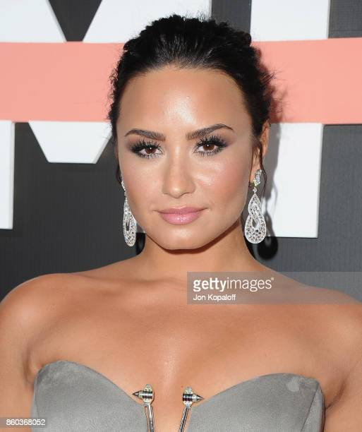 Demi Lovato arrives at the premiere of YouTube's 'Demi Lovato Simply Complicated' on October 11 2017 at the Fonda Theatre in Los Angeles California