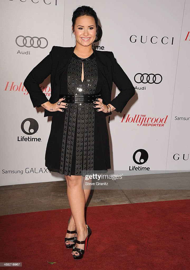 Demi Lovato arrives at the The Hollywood Reporter's Women In Entertainment Breakfast Honoring Oprah Winfrey at Beverly Hills Hotel on December 11, 2013 in Beverly Hills, California.