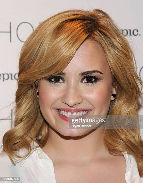 Demi Lovato attends X Factor's Topshop photo call with Demi Lovato 5th Harmony on May 13 2013 in New York City