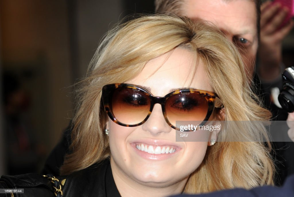 <a gi-track='captionPersonalityLinkClicked' href=/galleries/search?phrase=Demi+Lovato&family=editorial&specificpeople=4897002 ng-click='$event.stopPropagation()'>Demi Lovato</a> is mobbed by fans at Radio 1 on May 29, 2013 in London, England.