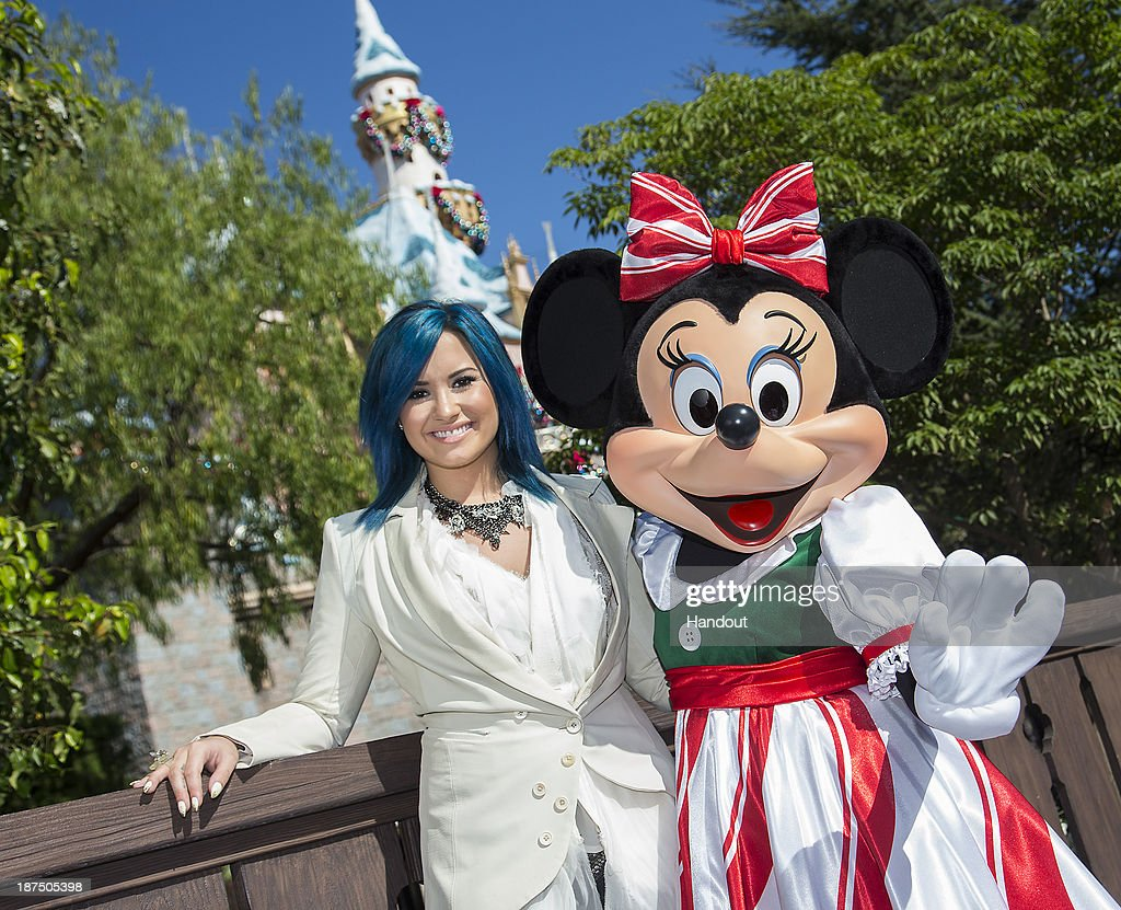 Demi Lovato meets Minnie Mouse during a break from taping the 'Disney Parks Christmas Day Parade' television special at Disneyland on November 9, 2013 in Anahiem, California. 'Disney Parks Christmas Day Parade' airs December 25 on ABC.