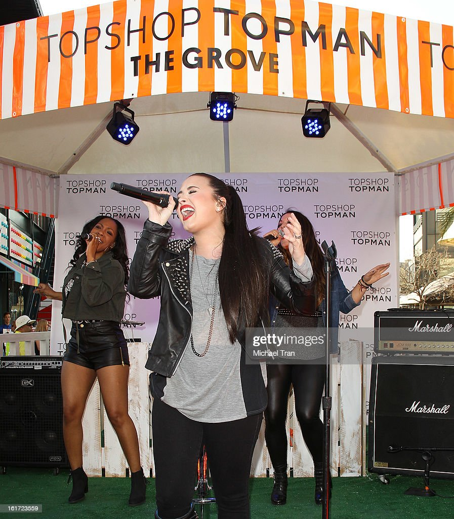 <a gi-track='captionPersonalityLinkClicked' href=/galleries/search?phrase=Demi+Lovato&family=editorial&specificpeople=4897002 ng-click='$event.stopPropagation()'>Demi Lovato</a> performs at Topshop Topman LA Grand Opening at The Grove on February 14, 2013 in Los Angeles, California.