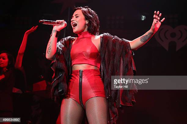 Demi Lovato performs during 1061 KISS FM's 2015Jingle Ball at American Airlines Center on December 1 2015 in Dallas Texas
