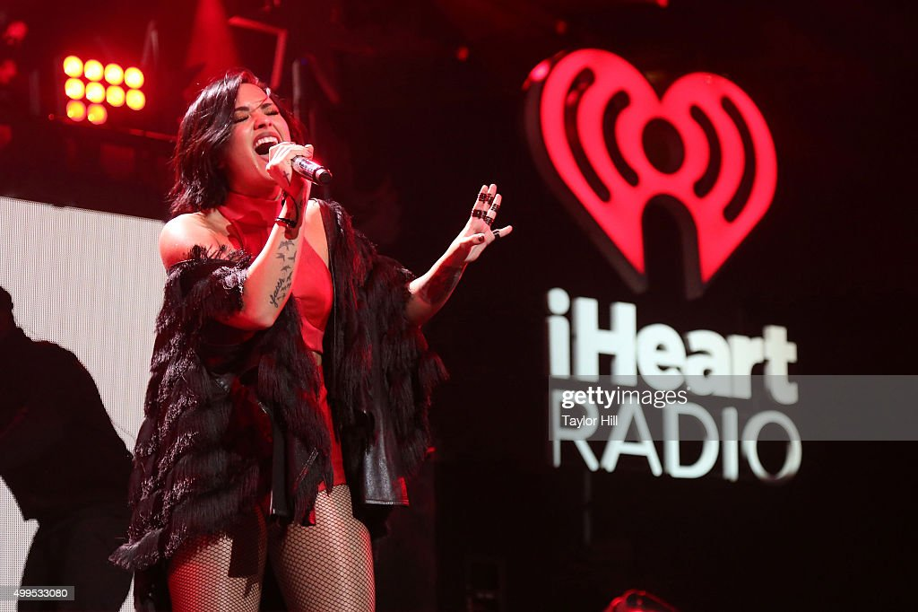 Demi Lovato performs during 106.1 KISS FM's Jingle Ball at American Airlines Center on December 1, 2015 in Dallas, Texas.