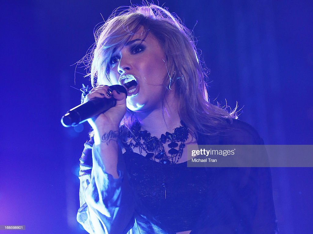 <a gi-track='captionPersonalityLinkClicked' href=/galleries/search?phrase=Demi+Lovato&family=editorial&specificpeople=4897002 ng-click='$event.stopPropagation()'>Demi Lovato</a> performs onstage during the 2013 KIIS FM's Wango Tango held at The Home Depot Center on May 11, 2013 in Carson, California.