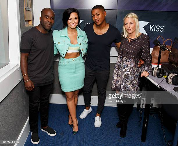 Demi Lovato poses with KISS Breakfast presenters Rickie Haywood Williams Charlie Hedges and Melvin O'Doom as she visits Kiss FM Studio's on September...