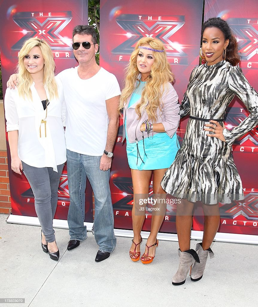 Demi Lovato, Simon Cowell, Paulina Rubio and Kelly Rowland attend Fox's 'The X Factor' Judges at Galen Center on July 11, 2013 in Los Angeles, California.