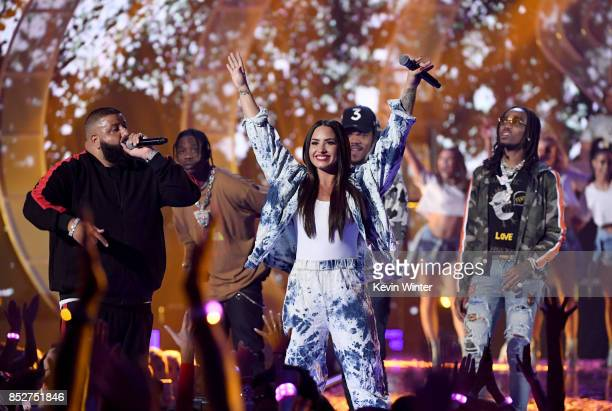 Demi Lovato with DJ Khaled Travis Scott Chance the Rapper and Quavo perform onstage during the 2017 iHeartRadio Music Festival at TMobile Arena on...