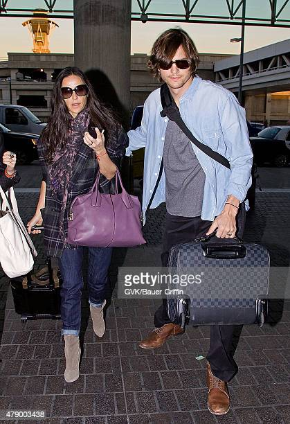 Demi Moore and Ashton Kutcher are seen at Los Angeles International Airport on January 26 2011 in Los Angeles California