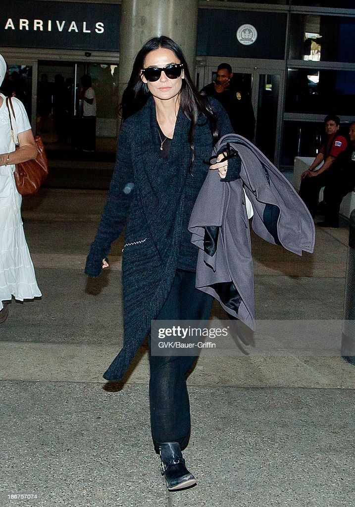 Demi Moore is seen arriving at LAX airport on November 03, 2013 in Los Angeles, California.