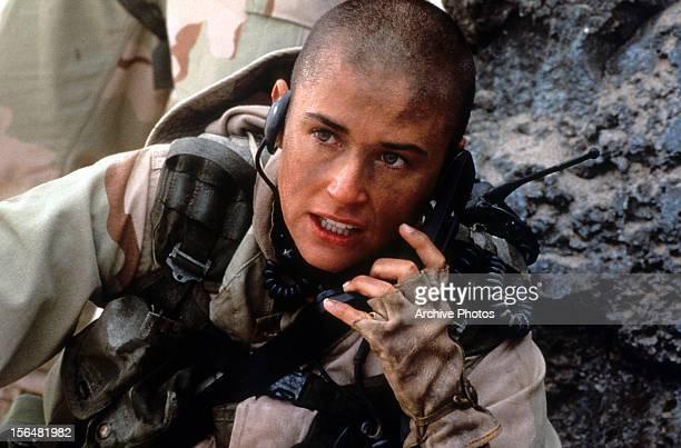 Demi Moore talking on walkie talkie in a scene from the film 'GI Jane' 1997