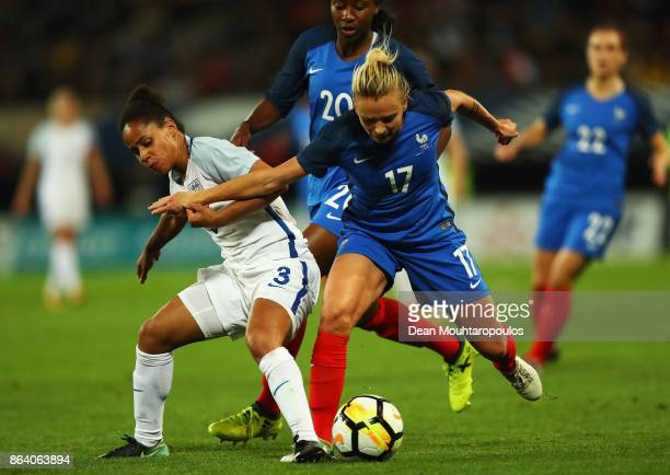 Demi Stokes of England batt Marion Torrent of France during the International friendly match between France and England held at Stade du Hainaut on...