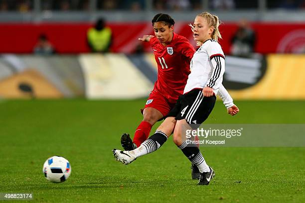 Demi Stokes of England challenges Leonie Maier of Germany during the Women's International Friendly match between Germany and England at...