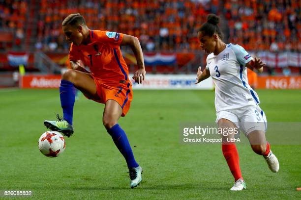 Demi Stokes of England challenges Shanice van de Sanden of the Netherlands during the UEFA Women's Euro 2017 Second Semi Final match between...