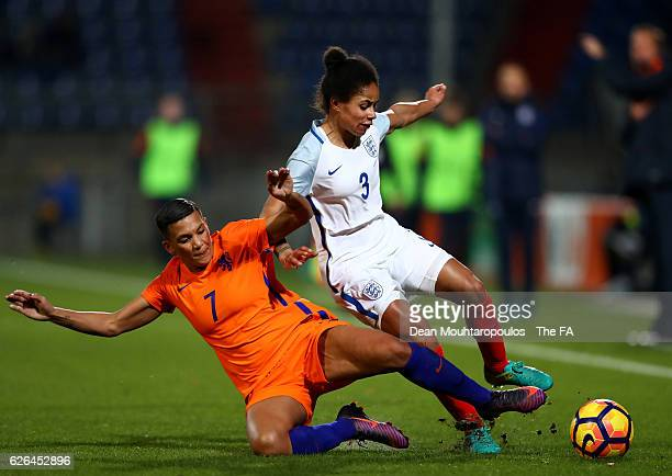 Demi Stokes of England Women is tackled by Shanice van de Sanden of Netherlands Women during the international friendly match between Netherlands...