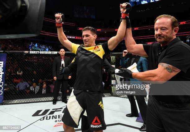 Demian Maia celebrates his victory over Jorge Masvidal in their welterweight fight during the UFC 211 event at the American Airlines Center on May 13...