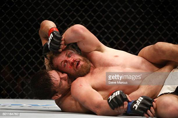 Demian Maia grapples with Gunnar Nelson in a welterweight fight during UFC 194 on December 12 2015 in Las Vegas Nevada
