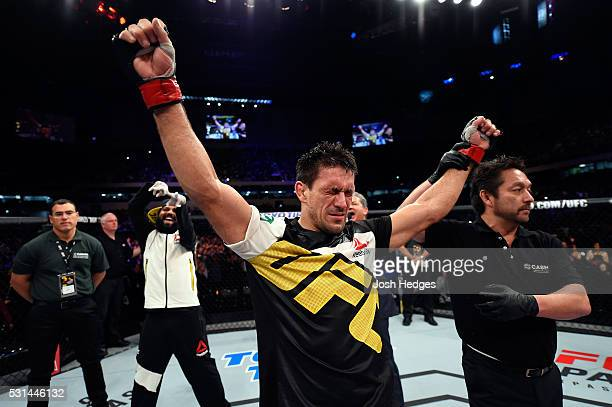 Demian Maia of Brazil celebrates after submitting Matt Brown in their welterweight bout during the UFC 198 event at Arena da Baixada stadium on May...