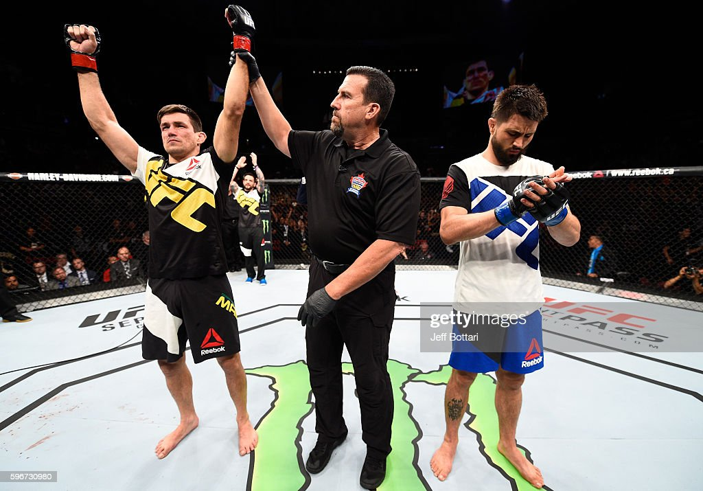 Demian Maia of Brazil celebrates his submission victory over Carlos Condit of the United States in their welterweight bout during the UFC Fight Night event at Rogers Arena on August 27, 2016 in Vancouver, British Columbia, Canada.