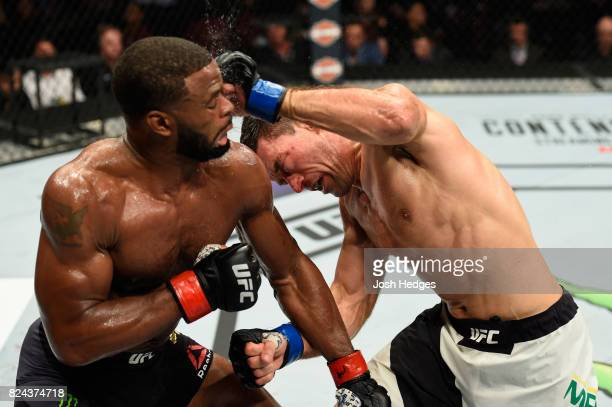 Demian Maia of Brazil punches Tyron Woodley in their UFC welterweight championship bout during the UFC 214 event at Honda Center on July 29 2017 in...