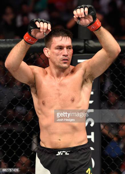 Demian Maia raises his hands after facing Demian Maia in their welterweight fight during the UFC 211 event at the American Airlines Center on May 13...