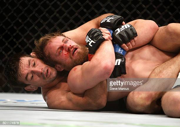 Demian Maia wrestles with Gunnar Nelson in a welterweight fight during UFC 194 at MGM Grand Garden Arena on December 12 2015 in Las Vegas Nevada