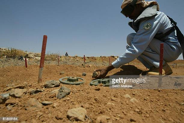 A deminer works in a field along the border between Jordan and Syria on July 08 and 2008 near Jaber Jordan The National Committee for Demining and...