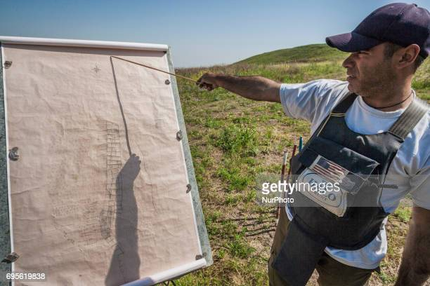 Deminers team coordinator of HALO Trust shows a landmines map of the hills of Nagorno Karabakh on 13 June 2017 Mines still remain after 25 years...