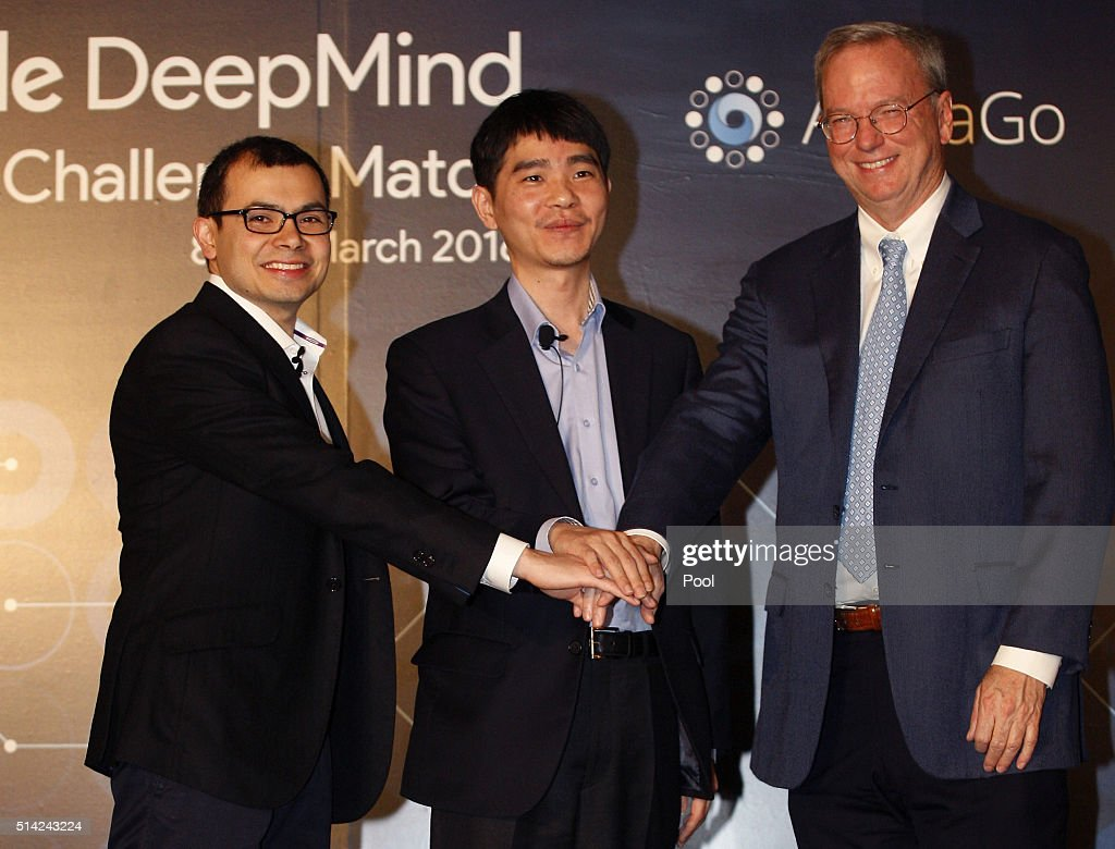 Demis Hassabis, CEO of Google's artificial intelligence (AI) startup DeepMind, South Korean professional Go player Lee Se-dol and Google CEO Eric Schmidt attend the press conference on March 8, 2016 in Seoul, South Korea. Lee Se-dol is set to play a five-game match against a computer program developed by a Google, AlphaGo, starting March 9.