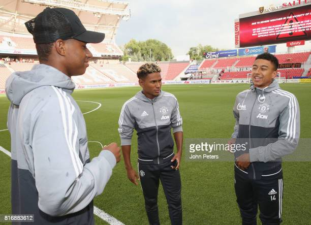 Demitri Mitchell Marcus Rashford and Jesse Lingard of Manchester United chat ahead of the preseason friendly match between Real Salt Lake and...