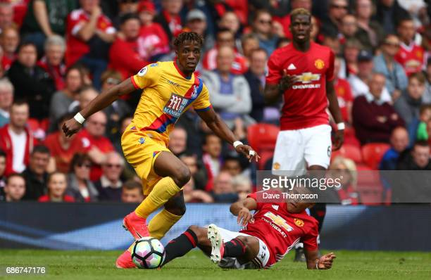 Demitri Mitchell of Manchester United and Wilfried Zaha of Crystal Palace during the Premier League match between Manchester United and Crystal...