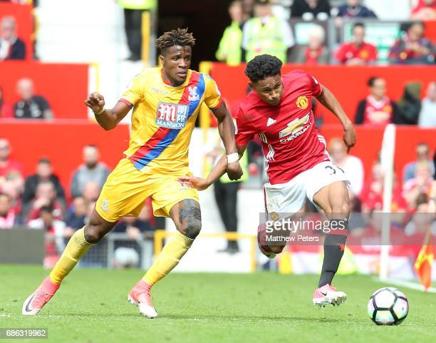 Demitri Mitchell of Manchester United in action with Wilfried Zaha of Crystal Palace during the Premier League match between Manchester United and...
