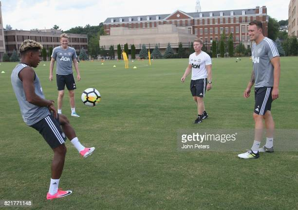 Demitri Mitchell Scott McTominay and Phil Jones of Manchester United in action during a first team training session as part of their preseason tour...