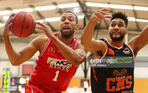 Demitrius Conger of the Hawks and Tevin Jackson of the Taipans compete for the ball during the 2017 NBL Blitz preseason match between the Cairns...
