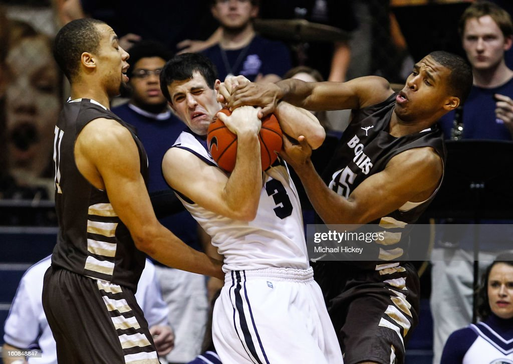 Demitrius Conger of the St Bonaventure Bonnies and Michael Davenport of the St Bonaventure Bonnies battle with Alex Barlow of the Butler Bulldogs for...