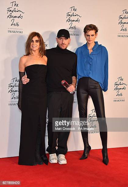 Demna Gvasalia and his award for International Ready To Wear Designer alongside Carine Roitfeld and Stella Tennant in the press room during The...