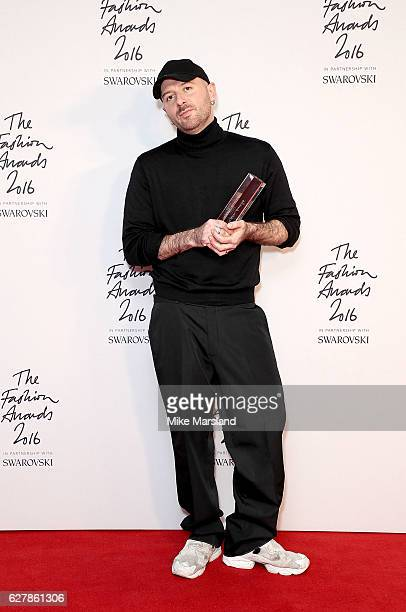 Demna Gvasalia winner of the International Urban Luxury Brand award poses at The Fashion Awards 2016 at Royal Albert Hall on December 5 2016 in...
