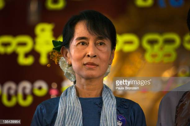 Democracy leader Aung San Suu Kyi stands along side party members for a group portrait during 20th anniversary ceremonies to honor her winning the...