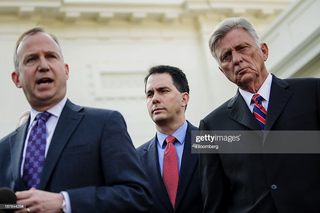 Democrat Jack Markell, governor of Delaware, left, speaks while Republican <a gi-track='captionPersonalityLinkClicked' href=/galleries/search?phrase=Scott+Walker+-+Politician&family=editorial&specificpeople=7511934 ng-click='$event.stopPropagation()'>Scott Walker</a>, governor of Wisconsin, center, and Democrat Mike Beebe, governor of Arkansas, listen during a press conference after meeting with U.S. President Barack Obama in Washington, D.C., U.S., on Tuesday, Dec. 4, 2012. Negotiations over the so-called fiscal cliff are stalled as President Obama and Republicans trade offers on ways to avoid more than $600 billion in U.S. spending cuts and tax increases for 2013 that will start to take effect in January if Congress doesn't act. Photographer: Andrew Harrer/Bloomberg via Getty Images