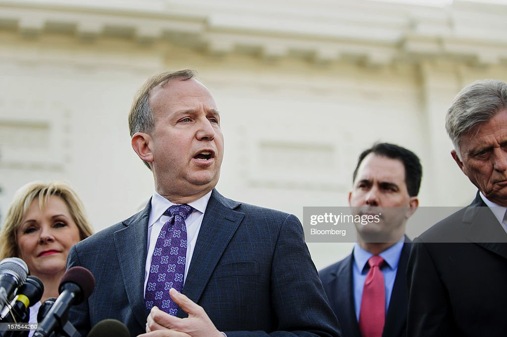 Democrat Jack Markell, governor of Delaware, second left, speaks while Republicans Mary Fallin, governor of Oklahoma, left, and Scott Walker, governor of Wisconsin, second right, listen with Democrat Mike Beebe, governor of Arkansas, during a press conference after meeting with U.S. President Barack Obama in Washington, D.C., U.S., on Tuesday, Dec. 4, 2012. Negotiations over the so-called fiscal cliff are stalled as President Obama and Republicans trade offers on ways to avoid more than $600 billion in U.S. spending cuts and tax increases for 2013 that will start to take effect in January if Congress doesn't act. Photographer: Andrew Harrer/Bloomberg via Getty Images