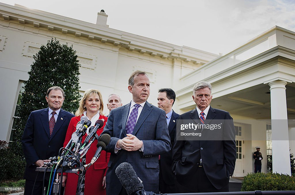 Democrat Jack Markell, governor of Delaware, third right, speaks while Republicans Gary Herbert, governor of Utah, left, Mary Fallin, governor of Oklahoma, second left, and Scott Walker, governor of Wisconsin, second right, listen with Democrats Mark Dayton, governor of Minnesota, third left, and Mike Beebe, governor of Arkansas, during a press conference after meeting with U.S. President Barack Obama in Washington, D.C., U.S., on Tuesday, Dec. 4, 2012. Negotiations over the so-called fiscal cliff are stalled as President Obama and Republicans trade offers on ways to avoid more than $600 billion in U.S. spending cuts and tax increases for 2013 that will start to take effect in January if Congress doesn't act. Photographer: Andrew Harrer/Bloomberg via Getty Images