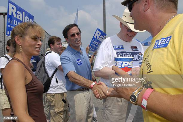 Democrat Josh Rale and his wife Debby greet republican voters during the 30th annual J Millard Tawes Crab and Clam Bake in Crisfield Maryland