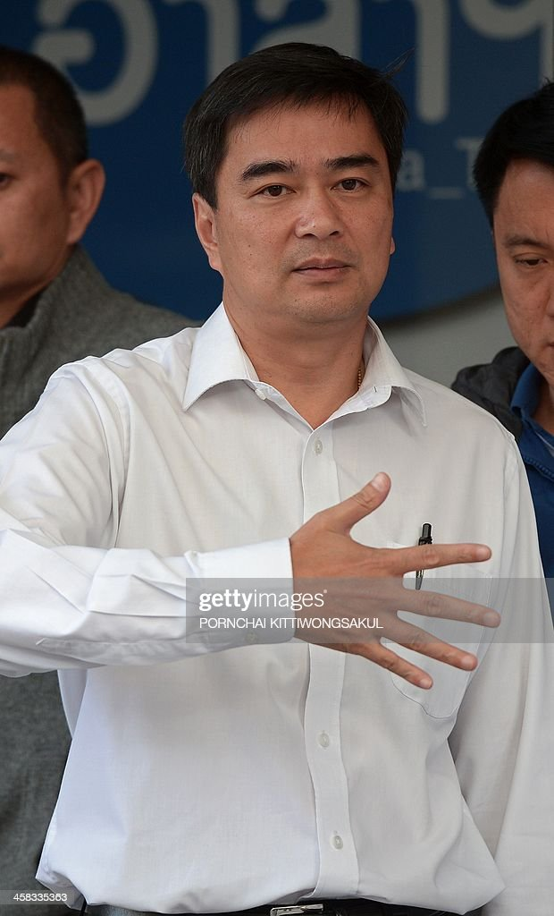 Democrat party leader <a gi-track='captionPersonalityLinkClicked' href=/galleries/search?phrase=Abhisit+Vejjajiva&family=editorial&specificpeople=645779 ng-click='$event.stopPropagation()'>Abhisit Vejjajiva</a> gestures during a press conference at the Democrat party in bangkok on December 21, 2013. Thailand's main opposition Democrat Party announced it would boycott snap elections in the crisis-gripped kingdom, piling further pressure on the government as protesters prepare to ramp up rallies aimed at suspending democracy. AFP PHOTO / PORNCHAI KITTIWONGSAKUL