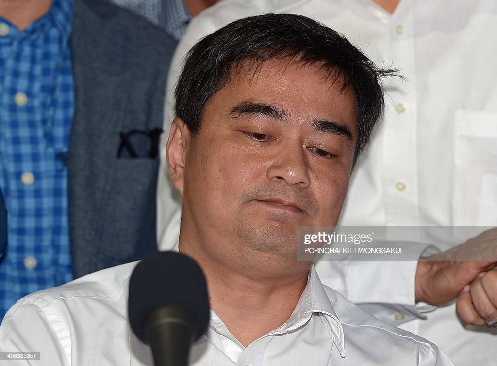 Democrat party leader Abhisit Vejjajiva reacts during a press conference at the Democrat party in bangkok on December 21, 2013. Thailand's main opposition Democrat Party announced it would boycott snap elections in the crisis-gripped kingdom, piling further pressure on the government as protesters prepare to ramp up rallies aimed at suspending democracy. AFP PHOTO / PORNCHAI KITTIWONGSAKUL