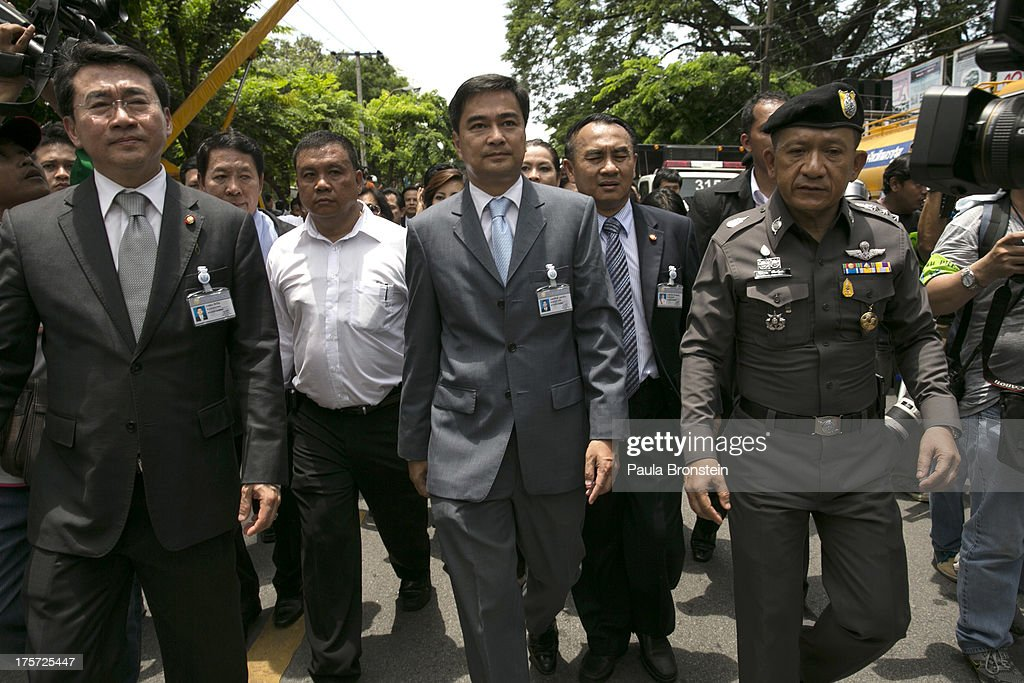 Democrat Party leader and former Prime Minister <a gi-track='captionPersonalityLinkClicked' href=/galleries/search?phrase=Abhisit+Vejjajiva&family=editorial&specificpeople=645779 ng-click='$event.stopPropagation()'>Abhisit Vejjajiva</a> gets escorted to the parliament building during an anti-government protest on August 7, 2013 in Bangkok, Thailand. Supporters of the Democratic led anti-government opposition to Yingluck Shinawatra's government gathered to protest against the Amnesty bill being debated in the Parliament.