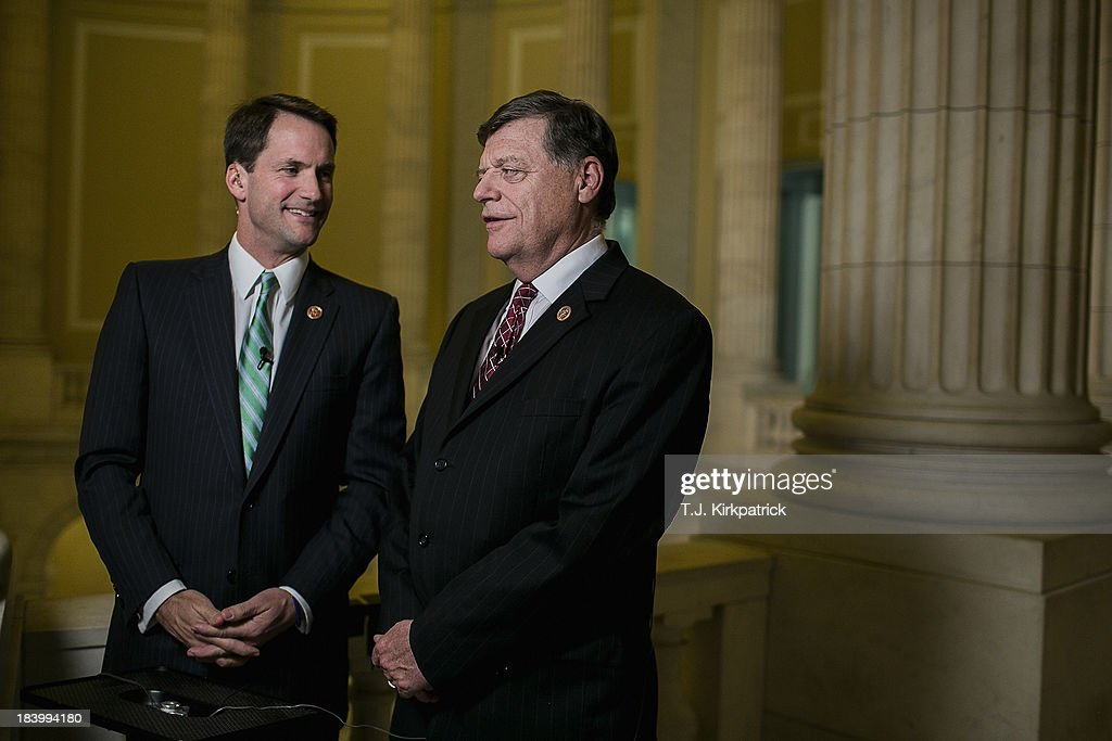 Democrat Representative Jim Himes (D-CT) (L), jokes with Republican Representative Tom Cole (R-OK) before a live CNN interview as congressional staff continue negotiations in to the night at the U.S. Capitol on October 10, 2013 in Washington, DC. House Speaker John Boehner suggested earlier today that Republicans may be willing to offer a short-term debt limit increase to allow for time to negotiate on reopening the government.