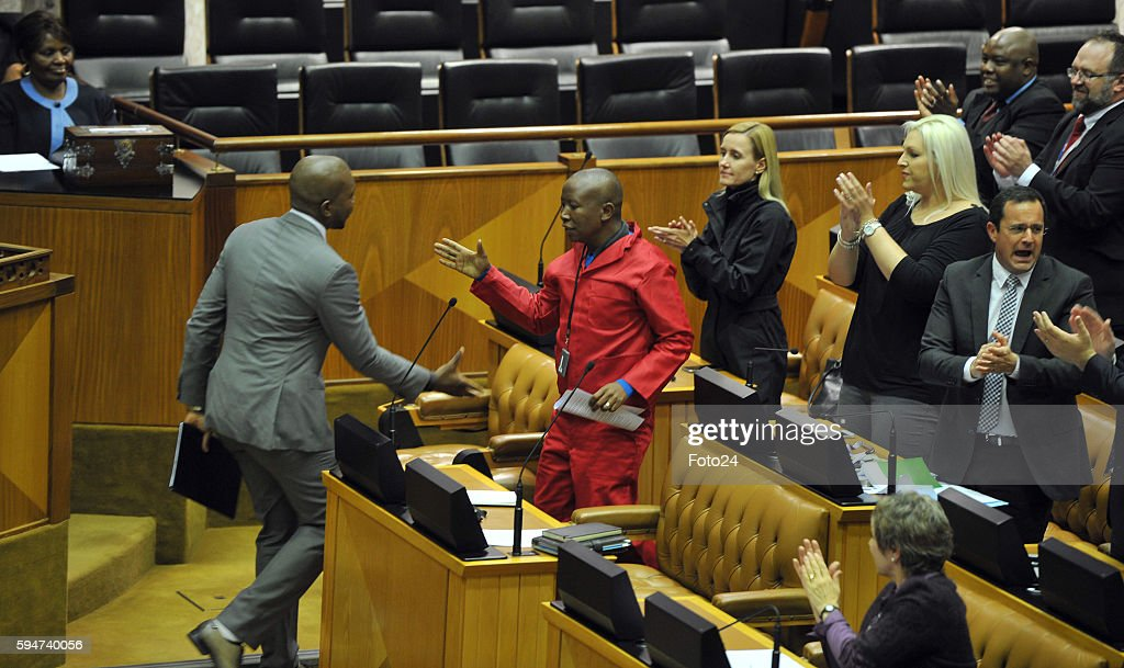 Democratic Alliance leader Mmusi Maimane approaches Economic Freedom Fighters leader Julius Malema during Parliaments post municipal elections debate...